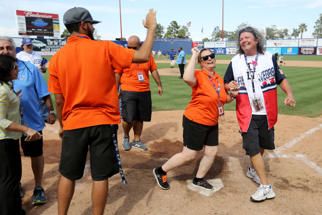 Ushers Oscar Pitt and her husband Jeff Pitt cross home plate after the Las Vegas 51s final game ever at Cashman Field in Las Vegas Monday, Sept. 3, 2018. The team will move to a new stadium in Sum ...