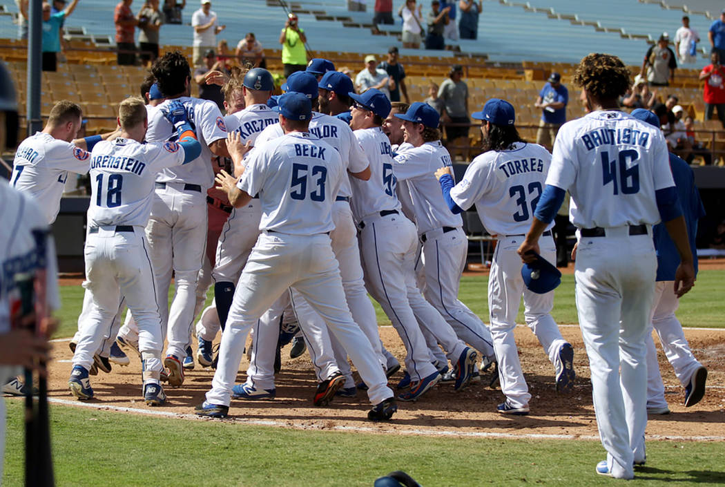 Las Vegas players mob Peter Alonso after his walk-off two-run home run during the final 51s game ever at Cashman Field in Las Vegas Monday, Sept. 3, 2018. (K.M. Cannon Las Vegas Review-Journal @KM ...