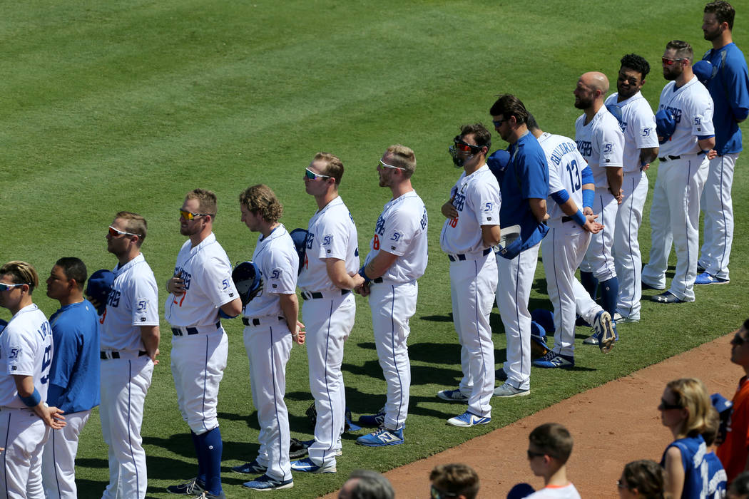 Las Vegas 51s stand during the National Anthem before their final game ever at Cashman Field in Las Vegas Monday, Sept. 3, 2018. The team will move to a new stadium in Summerlin next season. K.M. ...