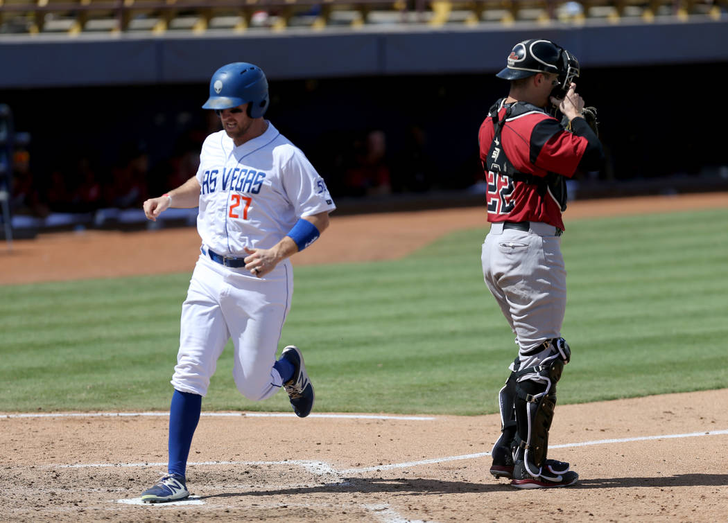 Las Vegas left fielder Patrick Kivlehan scores as Sacramento catcher Ronnie Freeman waits for the throw during the final 51s game ever at Cashman Field in Las Vegas Monday, Sept. 3, 2018. Las Vega ...