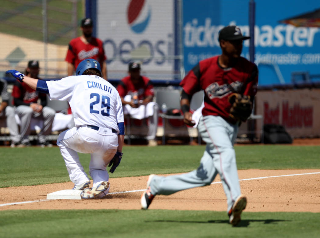 Las Vegas pitcher P.J. Conlon slides safely into third base during the final 51s game ever at Cashman Field in Las Vegas Monday, Sept. 3, 2018. Las Vegas beat Sacramento 4-3. The team will move to ...