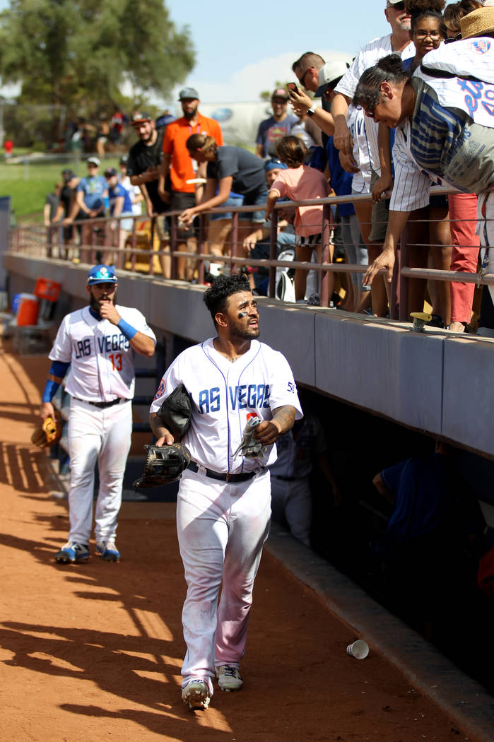 Las Vegas third baseman Christian Colon greets fans after the final 51s game ever at Cashman Field in Las Vegas Monday, Sept. 3, 2018. Las Vegas beat Sacramento 4-3. The team will move to a new s ...