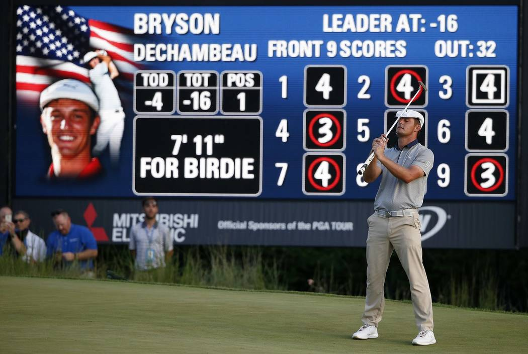 Bryson DeChambeau reacts after missing a birdie putt during the final round of the Dell Technologies Championship golf tournament at TPC Boston in Norton, Mass., Monday, Sept. 3, 2018. (AP Photo/M ...