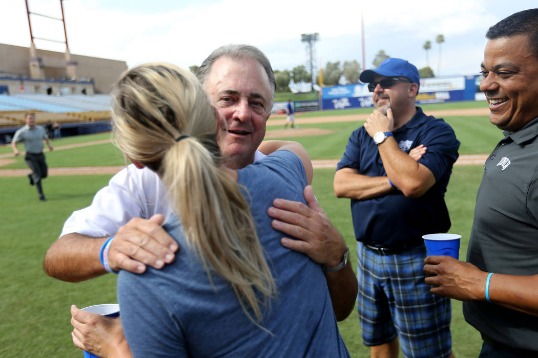 Las Vegas team president Don Logan hugs Shelby Little after the final 51s game ever at Cashman Field in Las Vegas Monday, Sept. 3, 2018. Las Vegas beat Sacramento 4-3. The team will move to a new ...