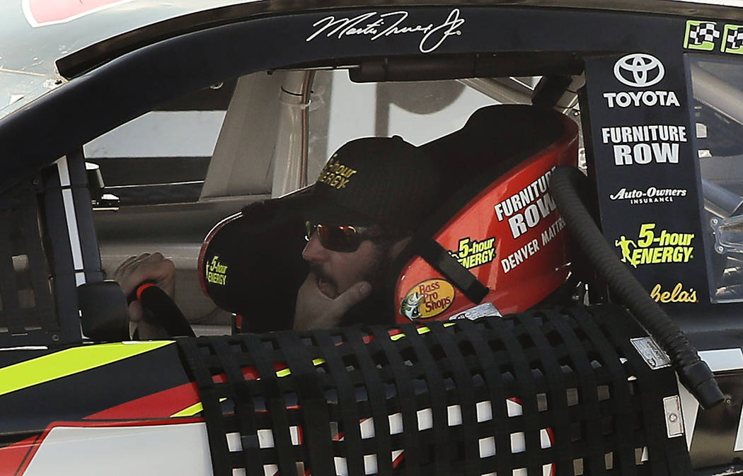 Martin Truex Jr. (78) sits in his car as he is pushed back to the garage after running out of gas on the home stretch during a NASCAR Cup Series auto race, Sunday, Aug. 5, 2018, in Watkins Glen, N ...
