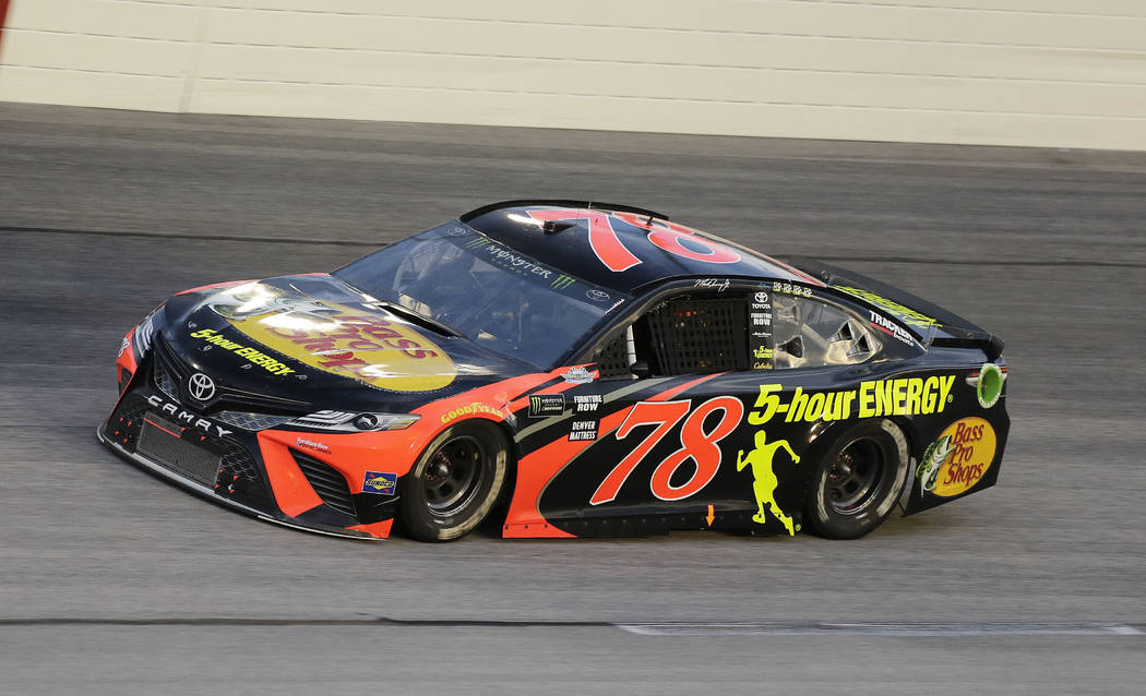 Martin Truex Jr. drives into Turn 1 during the NASCAR Cup Series auto race at Darlington Raceway, Sunday, Sept. 2, 2018, in Darlington, S.C. (AP Photo/Terry Renna)