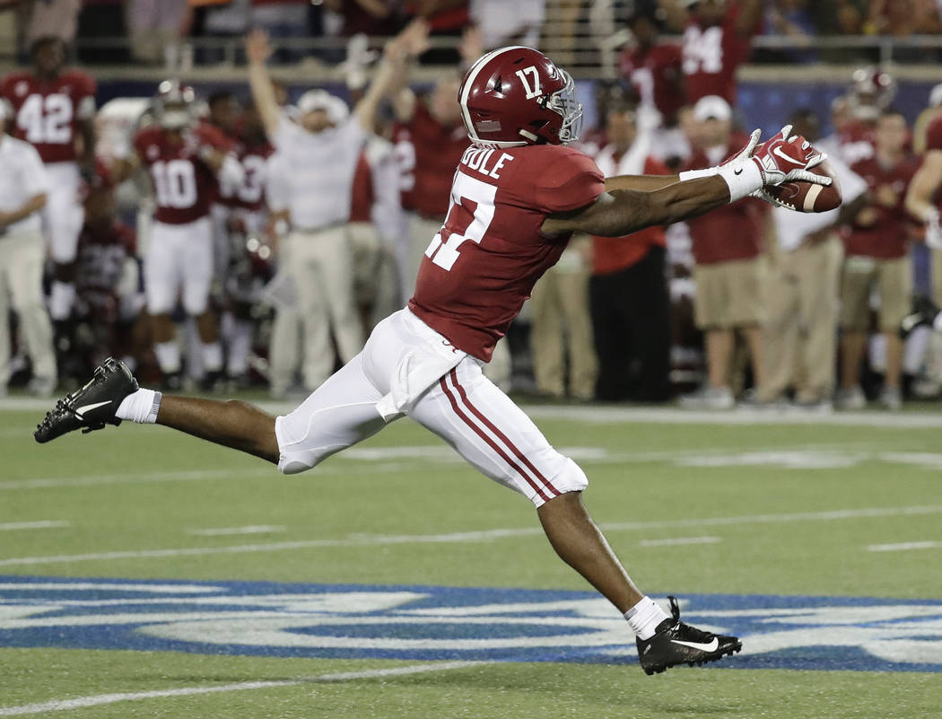 FILE - In this Sept. 1, 2018, file photo, Alabama wide receiver Jaylen Waddle makes a fingertip catch for a 49-yard reception against Louisville during the first half of an NCAA college football g ...