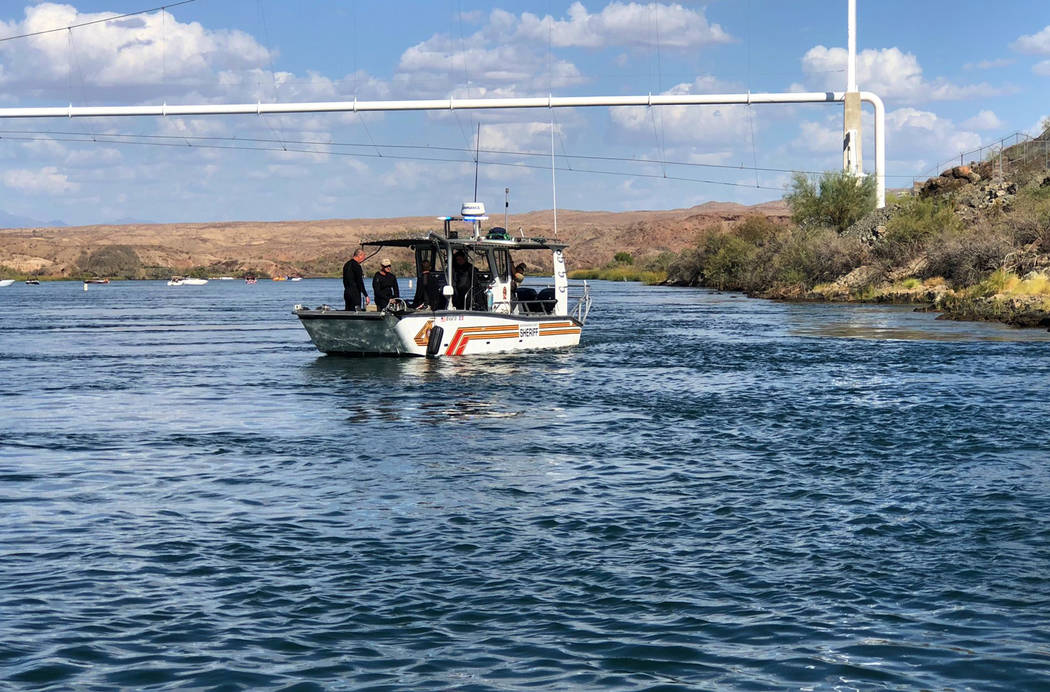 In this photo released by the San Bernardino County, Calif., Sheriff's Office, shows search and recovery operations Monday, Sept. 3, 2018, for three people missing after two boats collided Saturda ...