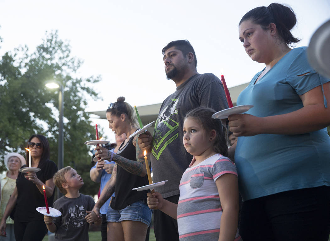 Jasmine Gonzalez, bottom/right, 5, holds a candle during a vigil for Levi Echenique, Daniel Theriot and Dejah Hunt at Sunset Park on Tuesday, Sept. 4, 2018, in Las Vegas. Benjamin Hager Las Vegas ...