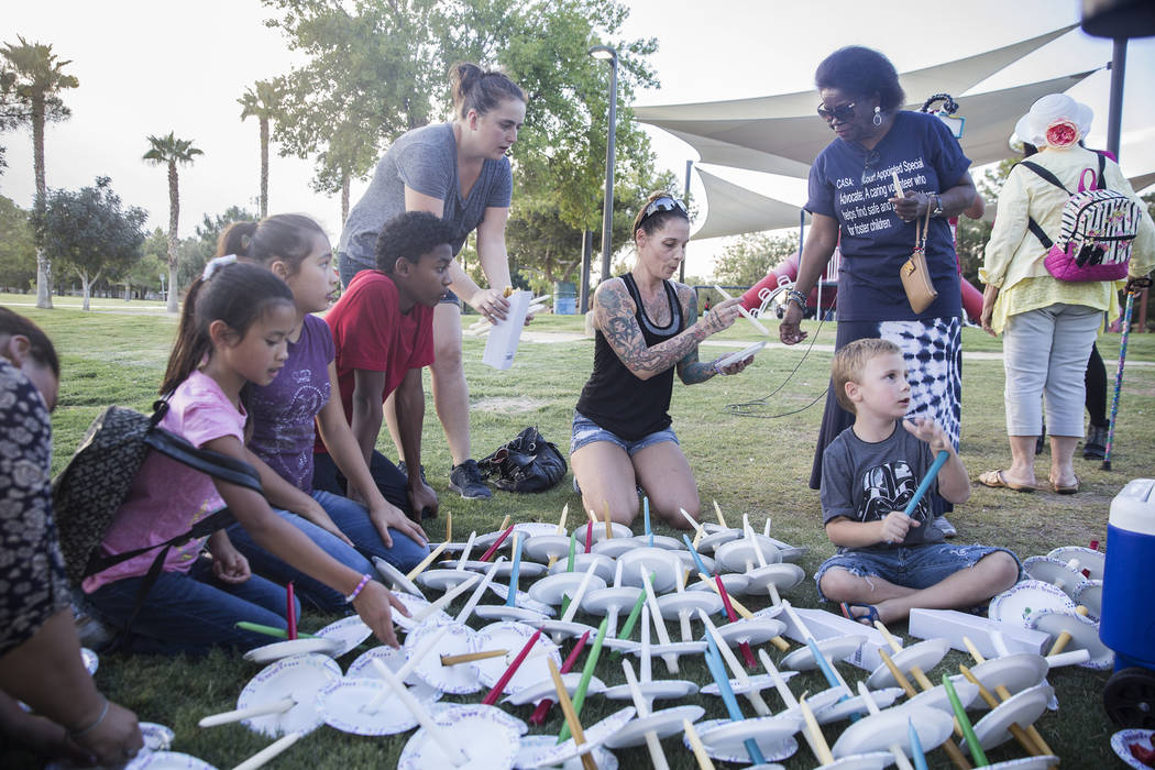 Attendees prepare candles before the start of a vigil for Levi Echenique, Daniel Theriot and Dejah Hunt at Sunset Park on Tuesday, Sept. 4, 2018, in Las Vegas. Benjamin Hager Las Vegas Review-Jour ...