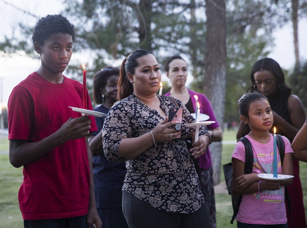 Aurion Mendiola, left, listens to a speaker during a vigil for Levi Echenique, Daniel Theriot and Dejah Hunt at Sunset Park on Tuesday, Sept. 4, 2018, in Las Vegas. Benjamin Hager Las Vegas Review ...