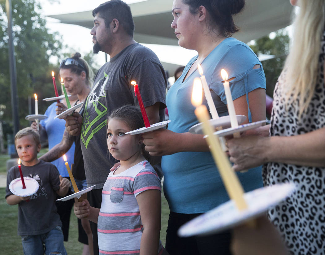 Jasmine Gonzalez, bottom/middle, 5, holds a candle during a vigil for Levi Echenique, Daniel Theriot and Dejah Hunt at Sunset Park on Tuesday, Sept. 4, 2018, in Las Vegas. Benjamin Hager Las Vegas ...