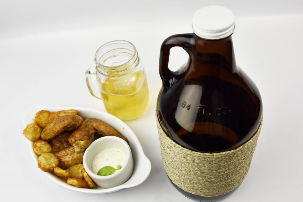Microbrewed Craft Ale Beer Glowler with Chicken Wings (Getty Images)