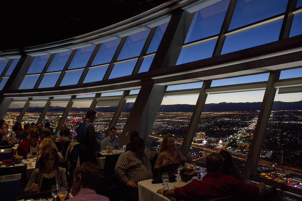 Patrons enjoy a Valentine's Day dinner as the sun sets on Tuesday, Feb. 14, 2017, at Top of the World restaurant at Stratosphere hotel-casino in Las Vegas. (Bridget Bennett/Las Vegas Review-Journa ...