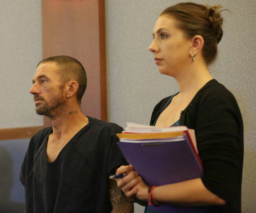 Joshua Oxford, center, who faces charges in the death of 3-year-old Daniel Theriot, appears in court with attorney Sarah Hawkins on Wednesday, Sept. 5, 2018. (Michael Quine/Las Vegas Review-Journa ...