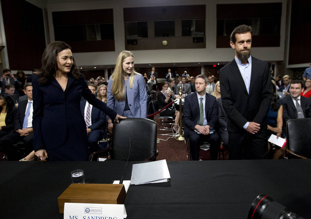 Facebook COO Sheryl Sandberg, left, accompanied byTwitter CEO Jack Dorsey arrive to the Senate Intelligence Committee hearing on 'Foreign Influence Operations and Their Use of Social Media Platfor ...