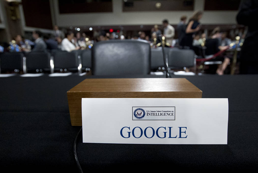 An empty chair reserved for Google's parent Alphabet, which refused to send its top executive, is seen as Facebook COO Sheryl Sandberg accompanied by Twitter CEO Jack Dorsey testify before the Sen ...