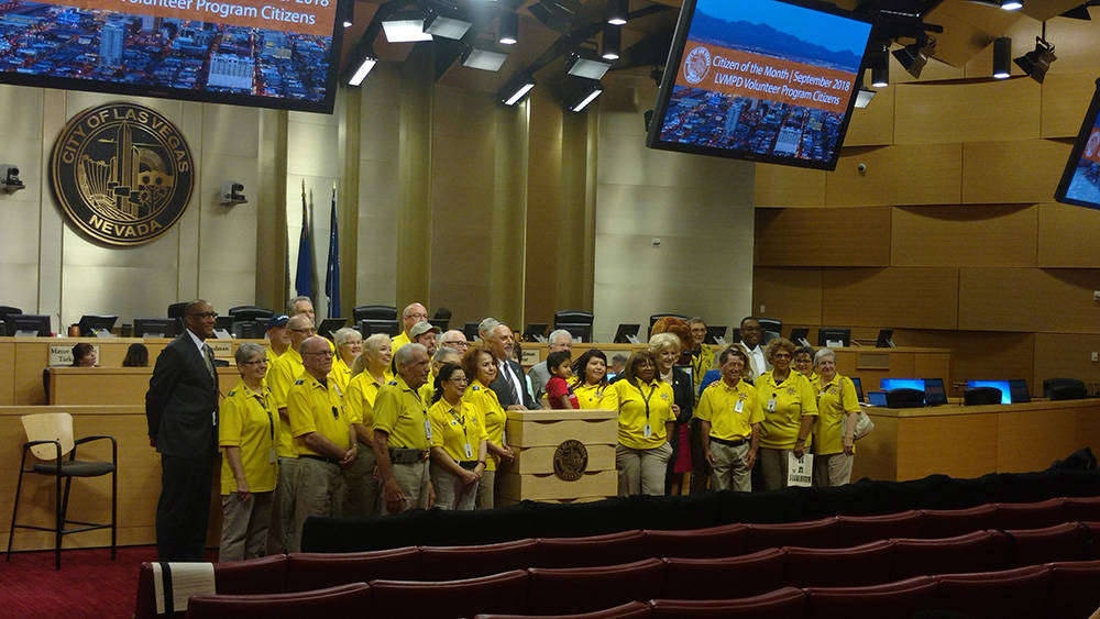 About 20 members of the Metro Volunteer Program accept the citizen of the month award Sept. 5 at Las Vegas City Hall. (Jacob Lasky/Las Vegas Review-Journal)