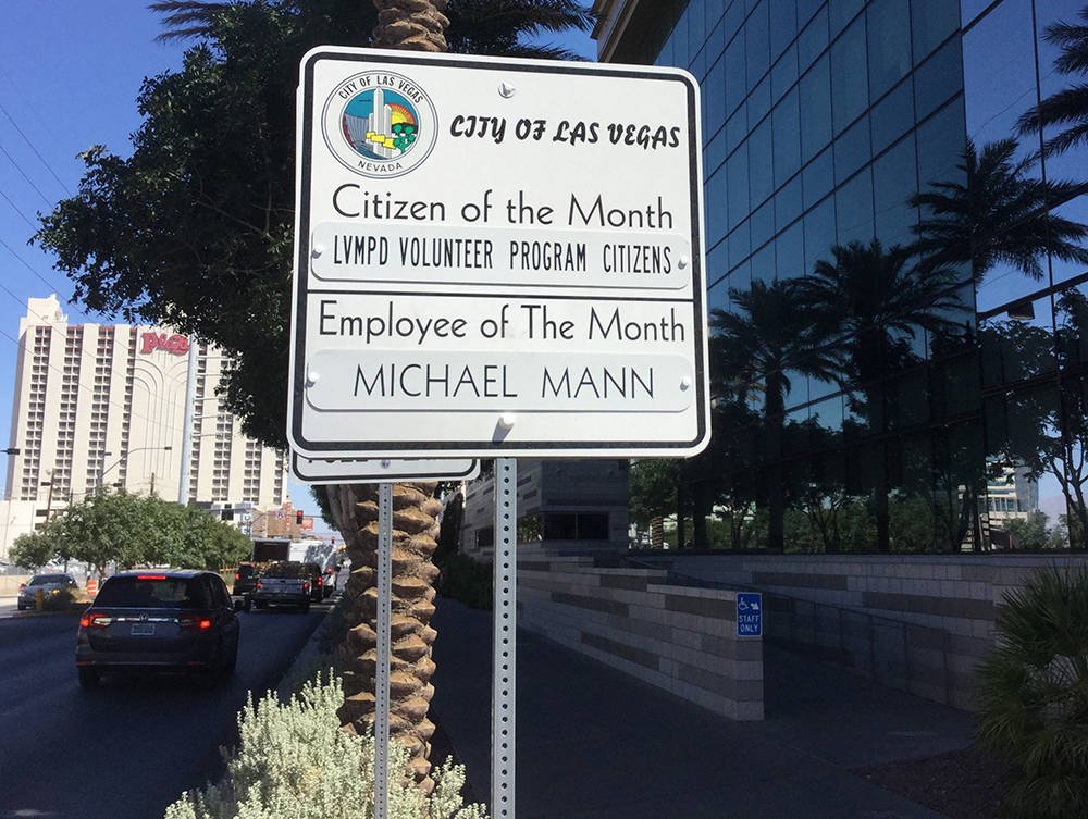 A sign outside City Hall recognizes the Metro Volunteer Program as September's citizen of the month. (Jacob Lasky/Las Vegas Review-Journal)