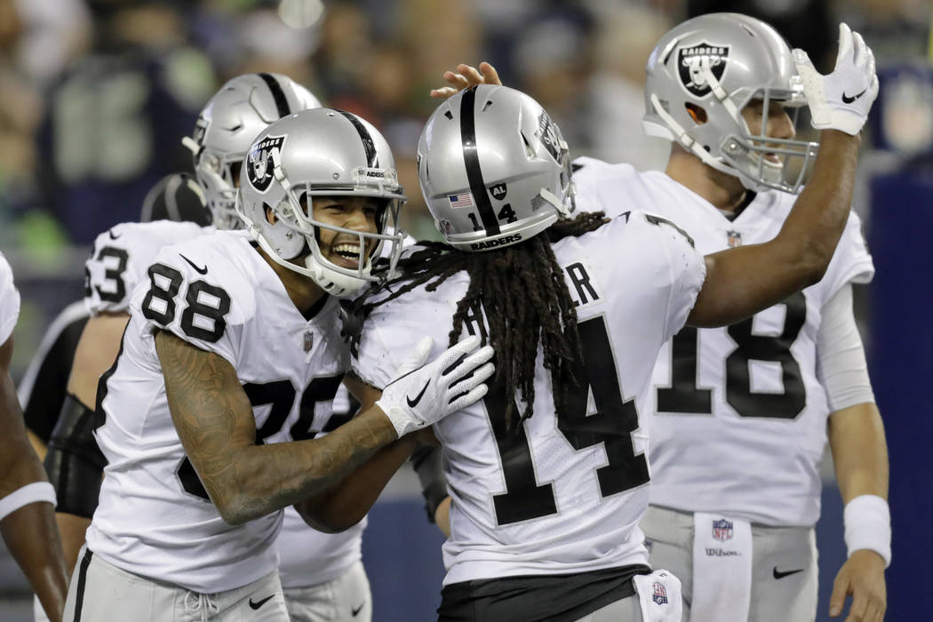 Oakland Raiders wide receiver Keon Hatcher (14) celebrates with wide receiver Marcell Ateman (88) after Hatcher scored a touchdown against the Seattle Seahawks during the second half of an NFL foo ...