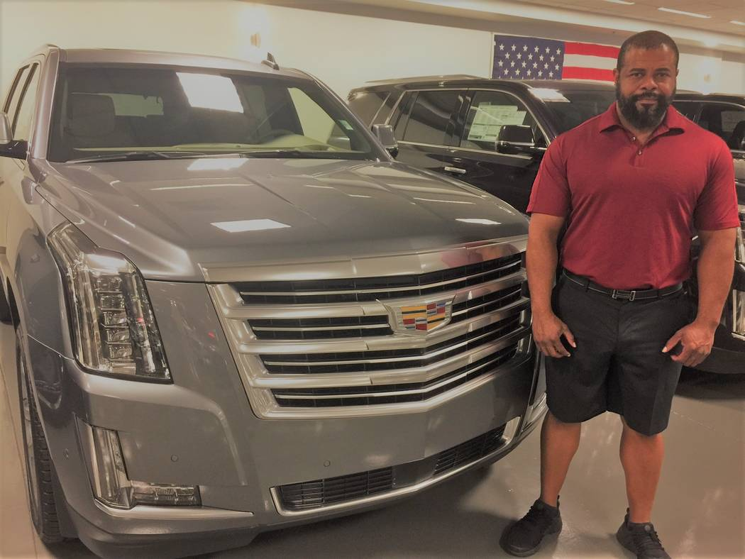 Findlay Cadillac Marketing Manager Sergio Brooks touts the 2018 Escalade at the dealership in Henderson's Valley Automall. (Findlay)
