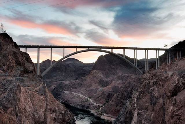 The 1,900-foot-long Hoover Dam bypass bridge, which opened in October 2010, crosses Black Canyon 900 feet above the Colorado River about a quarter of a mile downstream from Hoover Dam, which separ ...
