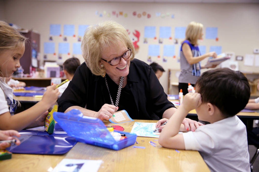 Just-retired kindergarten teacher Linda Verbon helps in a classroom at The Meadows School in Las Vegas Tuesday, Aug. 21, 2018. K.M. Cannon Las Vegas Review-Journal @KMCannonPhoto