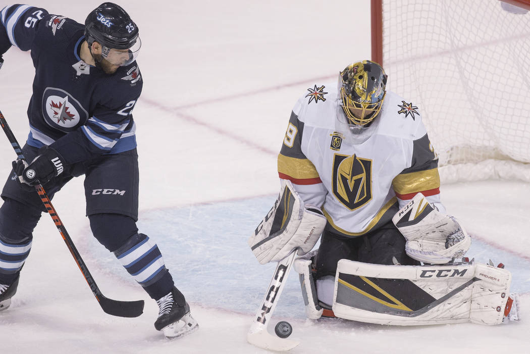 Golden Knights goaltender Marc-Andre Fleury (29) makes a save on Jets center Paul Stastny (25) in the first period during game five of the NHL Western Conference Finals on Sunday, May 20, 2018, at ...