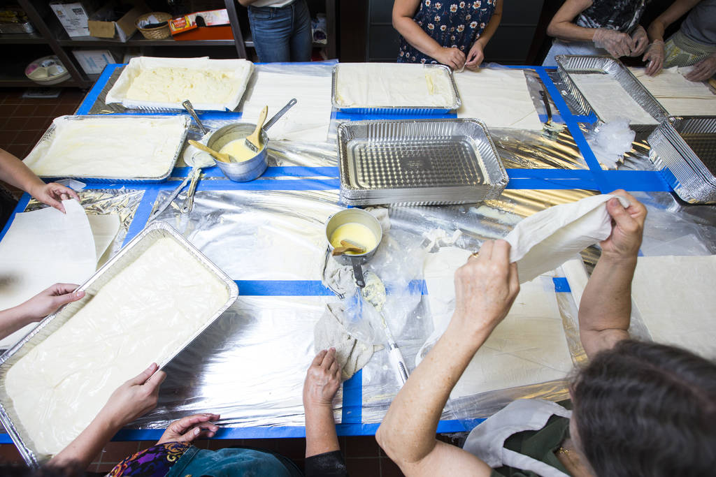 Volunteers prepare bougatsa, a cream-filled phyllo pastry, at St. John the Baptist Greek Orthodox Church ahead of the annual Las Vegas Greek Food Festival, slated to begin Sept. 14, in Las Vegas o ...