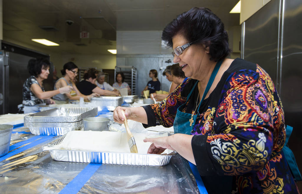Volunteer Kiki Mavrantonis prepares bougatsa, a cream-filled phyllo pastry, at St. John the Baptist Greek Orthodox Church ahead of the annual Las Vegas Greek Food Festival, slated to begin Sept. 1 ...