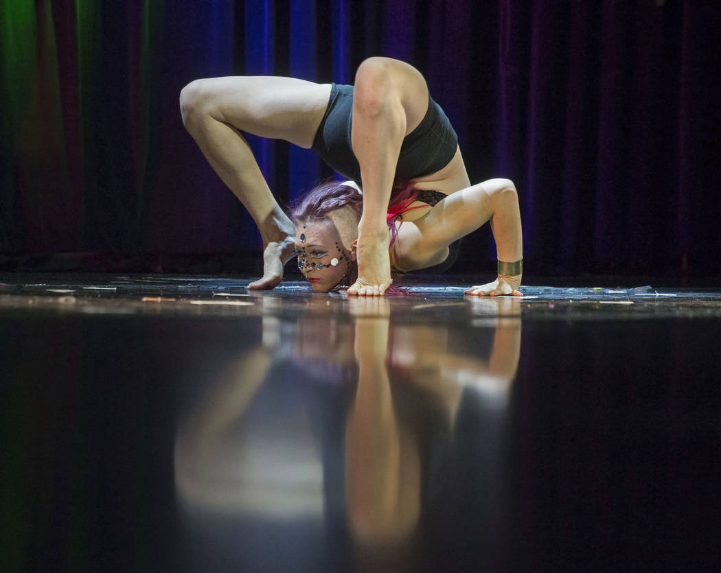 "Lisbeth Mikoleit performs ""All the White Horses"" during the International Congress of Contortionists on Wednesday, Sept. 5, 2018, at Sunset Station, in Las Vegas. Benjamin Hager Las Vega ..."