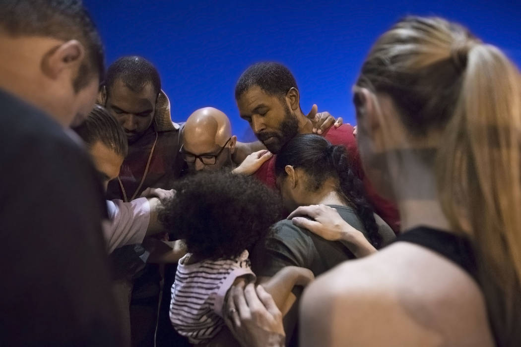 Licensed mental health therapist Sheldon Jacobs, top/right, is blessed by members of Shadow Hills Church before he hits the streets on Friday, Aug. 31, 2018, at Ethel Pearson Park, in Las Vegas. B ...