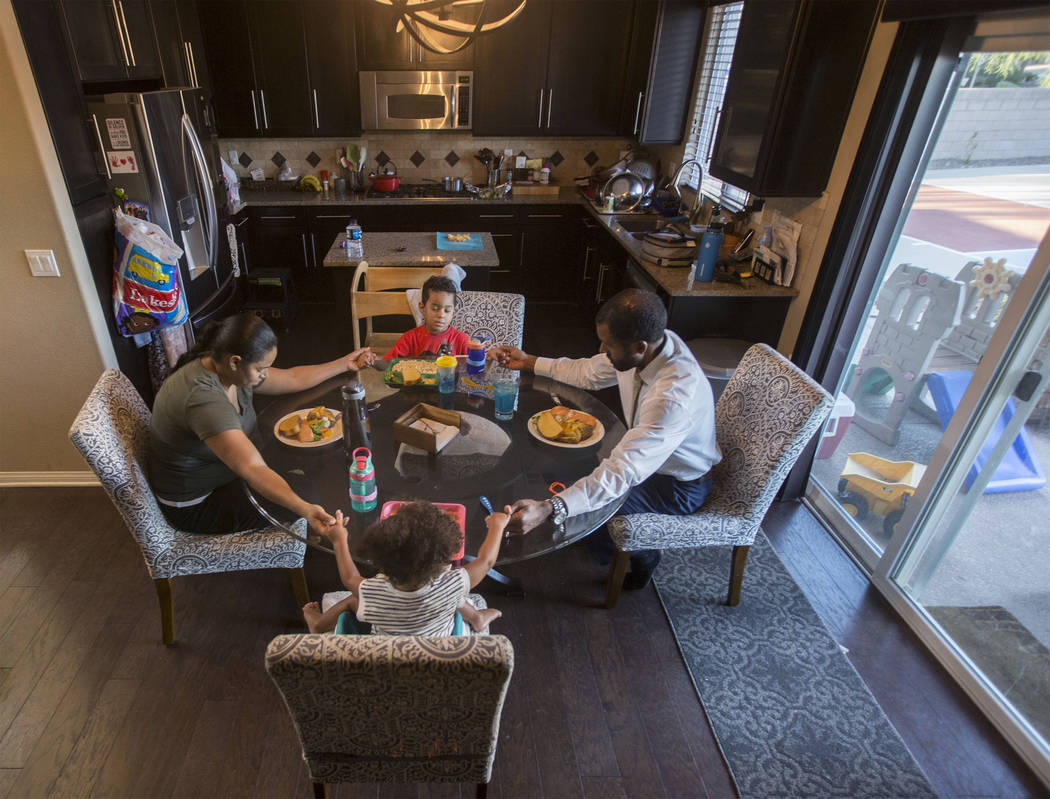 Licensed mental health therapist Sheldon Jacobs, right, prays with wife Nicole, daughter Arianna and son Jayden before his last guaranteed meal for the next 48 hours on Friday, Aug. 31, 2018, at J ...