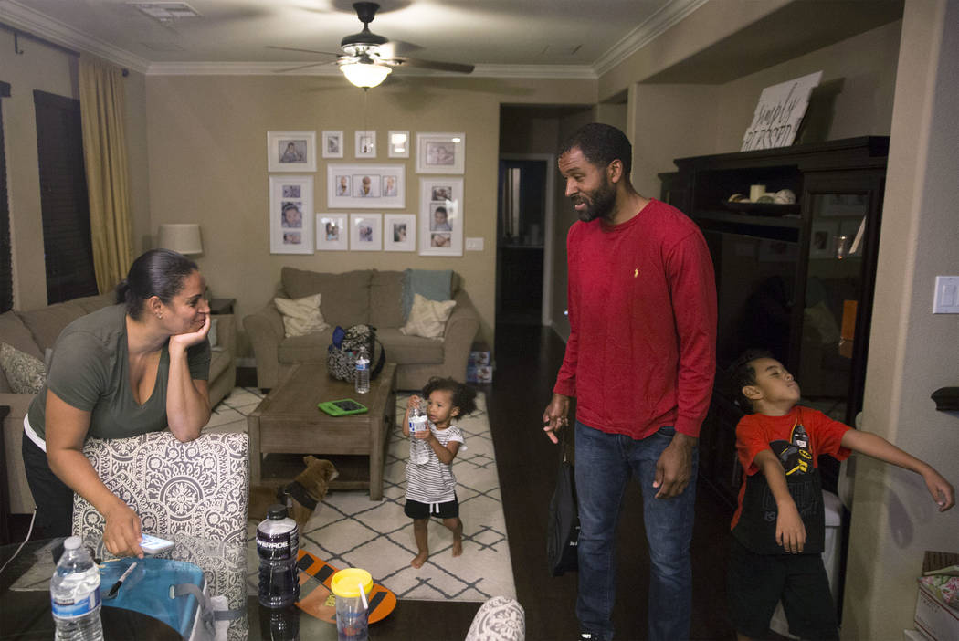 Licensed mental health therapist Sheldon Jacobs, second from right, spends time wife Nicole, daughter Arianna and son Jayden on Friday, Aug. 31, 2018, at Jacobs home, in Las Vegas. Benjamin Hager ...
