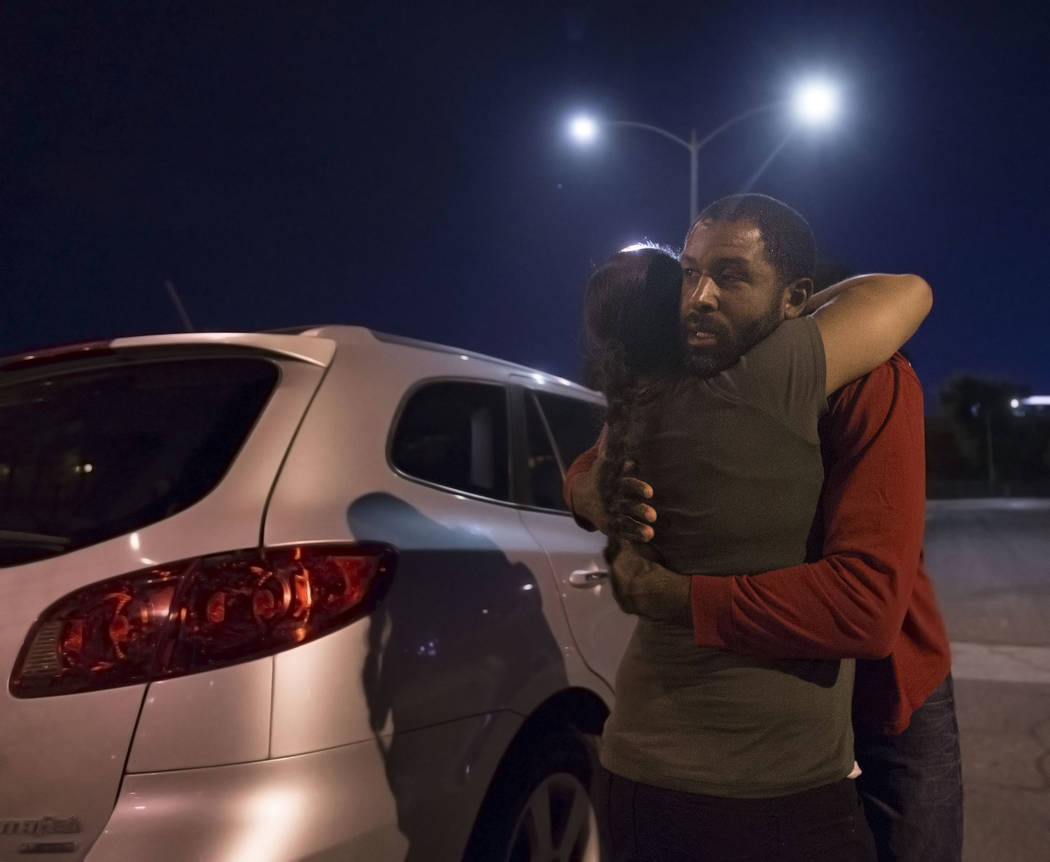 Licensed mental health therapist Sheldon Jacobs, right, hugs his wife Nicole before hitting the streets posing as a homeless man on Friday, Aug. 31, 2018, at Ethel Pearson Park, in Las Vegas.