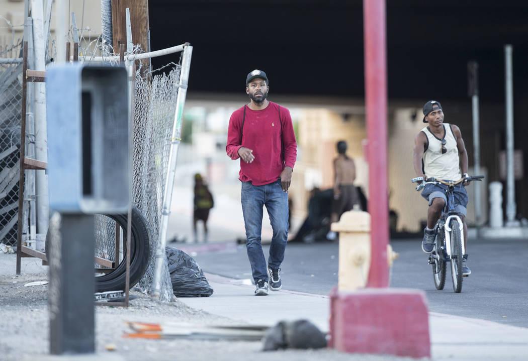 Licensed mental health therapist Sheldon Jacobs, left, posing as a homeless man, walks on North City Parkway near West Bonanza Road on Sunday, Sept. 2, 2018, in Las Vegas. Benjamin Hager Las Vegas ...