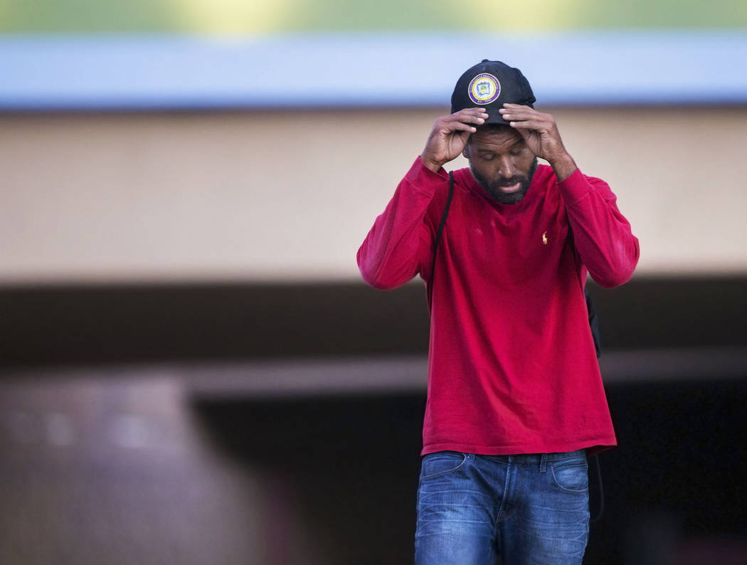 Licensed mental health therapist Sheldon Jacobs, posing as a homeless man, takes a moment to cool off near North City Parkway and West McWilliams Avenue on Sunday, Sept. 2, 2018, in Las Vegas. Ben ...