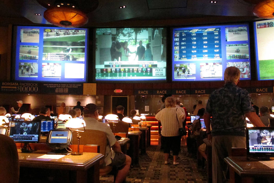 In this June 14, 2018, file photo, bettors wait to make wagers on sporting events at the Borgata casino in Atlantic City, N.J., hours after it began accepting sports bets.(AP Photo/Wayne Parry, File)