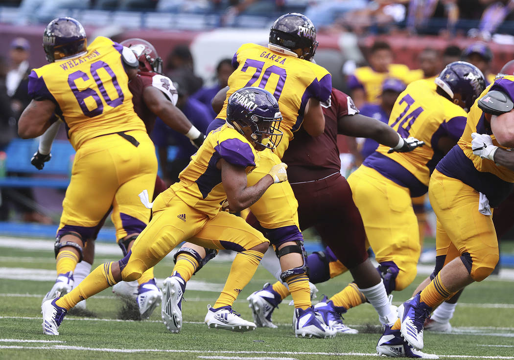 The offensive line gives Prairie View A&M running back Dawonya Tucker running room as he breaks free for a long run against North Carolina Central during the first half of the MEAC-SWAC Challe ...