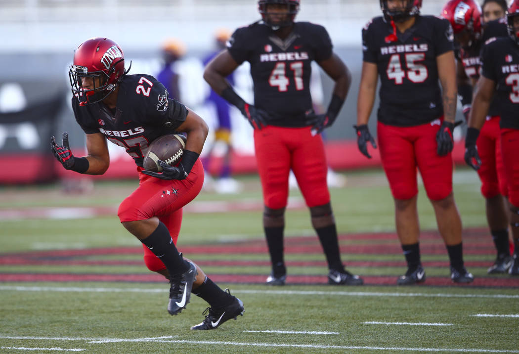 UNLV Rebels linebacker Austin Ajiake (27) runs the ball while warming up before a football game against Prairie View A&M Panthers at Sam Boyd Stadium in Las Vegas on Saturday, Sept. 15, 2018. ...