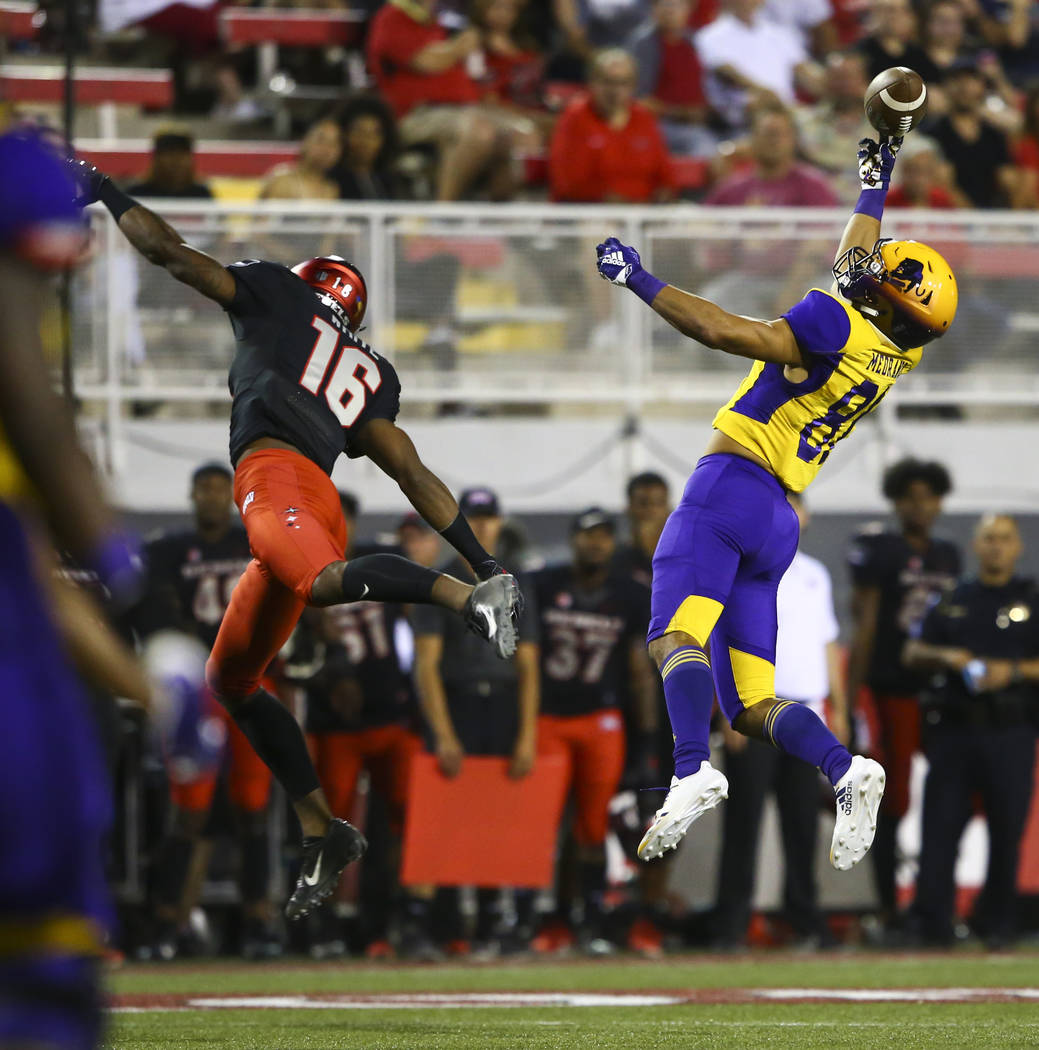 Prairie View A&M Panthers tight end Jose Medrano (81) goes up for a pass in front of UNLV Rebels linebacker Javin White (16) during the first half of a football game at Sam Boyd Stadium in Las ...