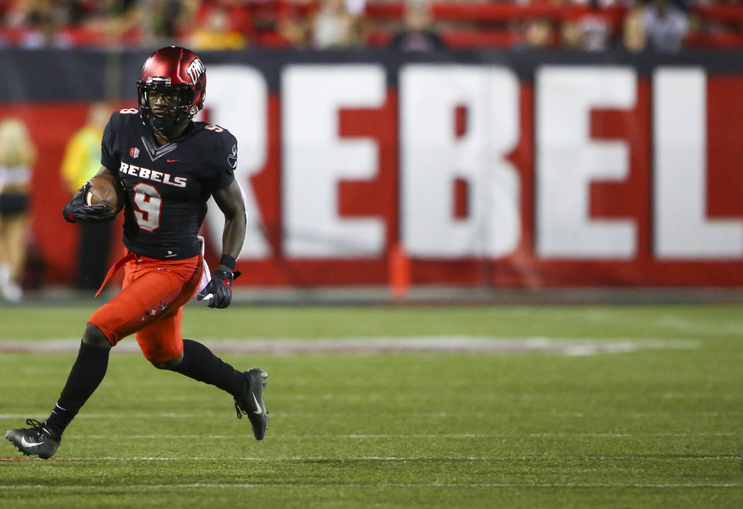 UNLV Rebels wide receiver Tyleek Collins (9) runs the ball against the Prairie View A&M Panthers during the first half of a football game at Sam Boyd Stadium in Las Vegas on Saturday, Sept. 15 ...