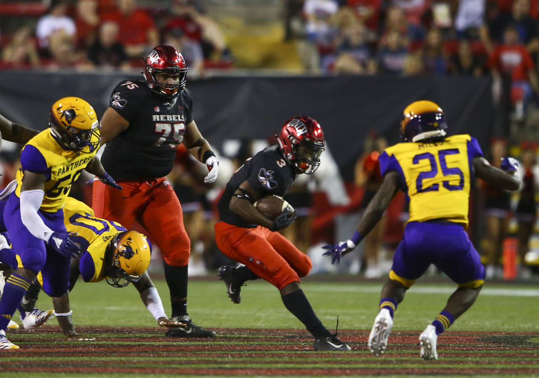 UNLV Rebels running back Lexington Thomas (3) looks to get past Prairie View A&M Panthers safety Willie Miles (25) during the first half of a football game at Sam Boyd Stadium in Las Vegas on ...