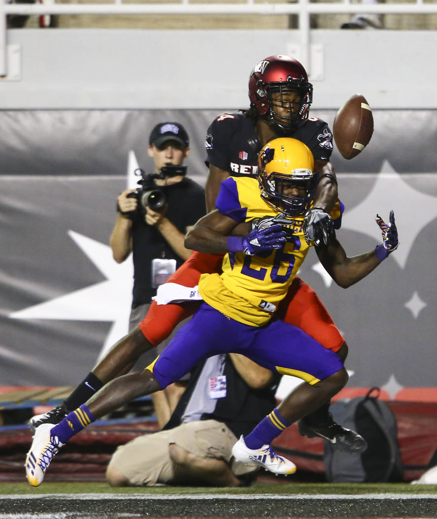 Prairie View A&M Panthers cornerback Ju'Anthony Parker (26) draws a call for pass interference in front of UNLV Rebels wide receiver Kendal Keys (84) during the first half of a football game a ...