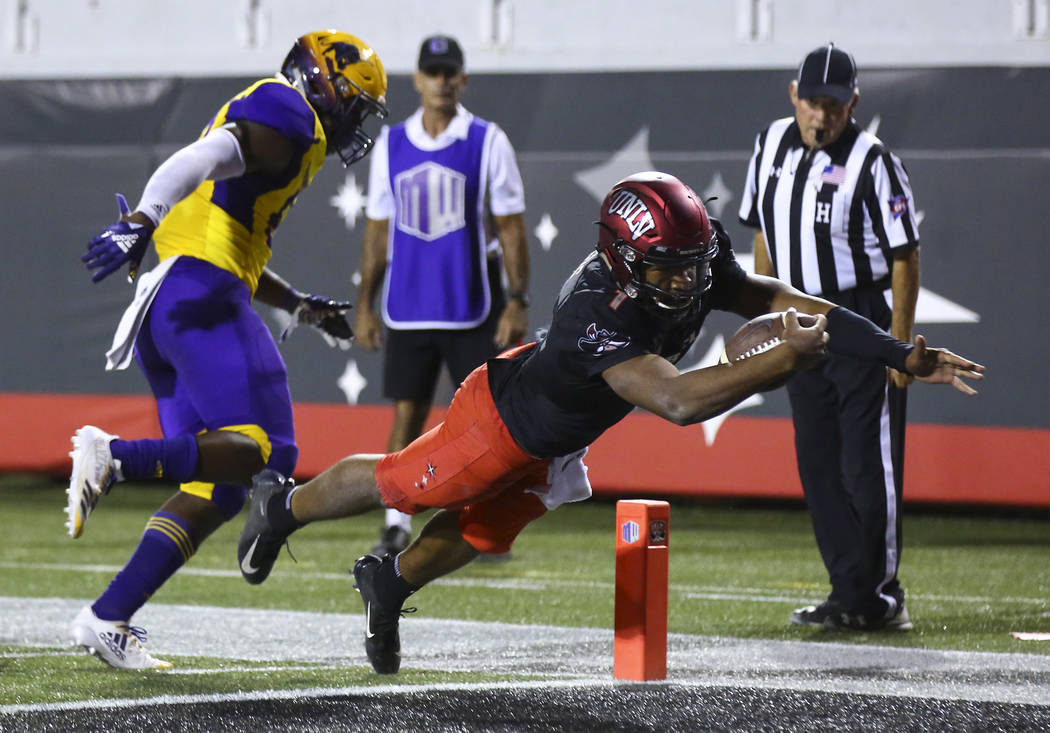 UNLV Rebels quarterback Armani Rogers (1) dives to score a touchdown past Prairie View A&M Panthers linebacker Isaac Claiborne (59) during the second half of a football game at Sam Boyd Stadiu ...