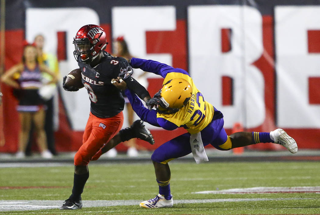 Prairie View A&M Panthers cornerback Jaylen Harris (23) tries to take down UNLV Rebels running back Lexington Thomas (3) during the second half of a football game at Sam Boyd Stadium in Las Ve ...