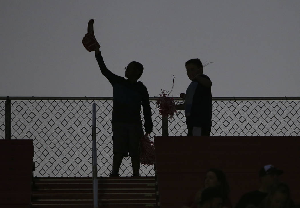 A pair of young football fans are silhouetted before the start of a football game between the UNLV Rebels and Prairie View A&M Panthers at Sam Boyd Stadium in Las Vegas on Saturday, Sept. 15, ...