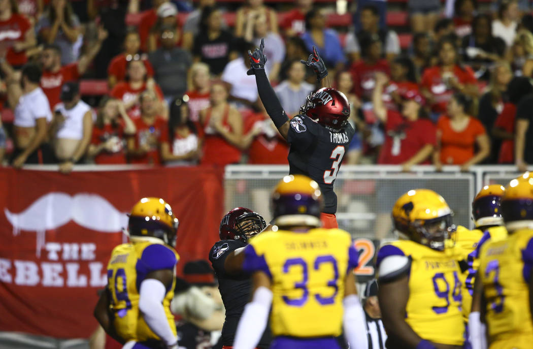 UNLV Rebels running back Lexington Thomas (3) celebrates a touchdown against Prairie View A&M Panthers during the first half of a football game at Sam Boyd Stadium in Las Vegas on Saturday, Se ...