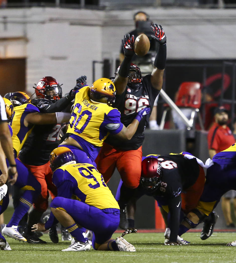 UNLV Rebels defensive lineman Montrice Johns (96) blocks a kick from the Prairie View A&M Panthers in front of Prairie View A&M Panthers offensive lineman Donovan Wheaton (60) during the f ...