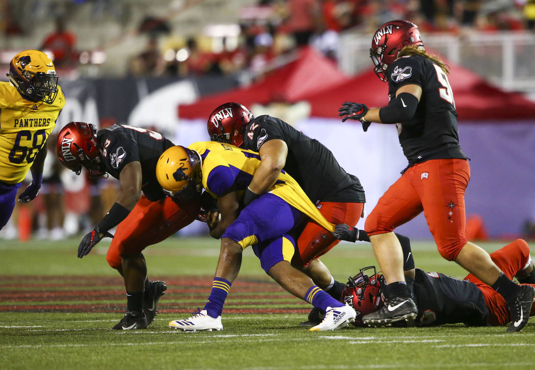 Prairie View A&M Panthers quarterback Jalen Morton (12) is taken down by UNLV Rebels defensive lineman Salanoa-Alo Wily (42) during the first half of a football game at Sam Boyd Stadium in Las ...